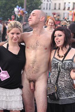Clothed male naked female public