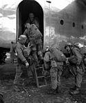 CONFLICT IN KOREA- Airborne troops board plane for their drop behind enemy lines north of Pyonyang, Korea.-NARA FILE-- 111-SC-351493 111-SC-351493.jpg