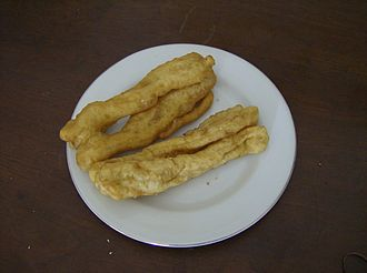 Youtiao - In Indonesia, the fried dough is known as cakwe and is commonly chopped or thinly sliced and then eaten for breakfast.