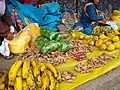 Calca Peru- Bagged coca leaves on top of ginger root for sale.jpg