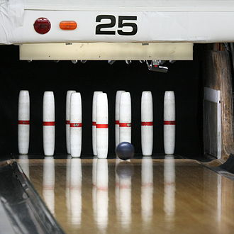 Bowling pin - A full rack of ten candlepins, with the sport's small ball.