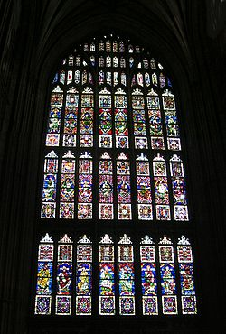 A large Perpendicular style Gothic window of eight lights in Canterbury Cathedral, c. 1400, which contains medieval glass.