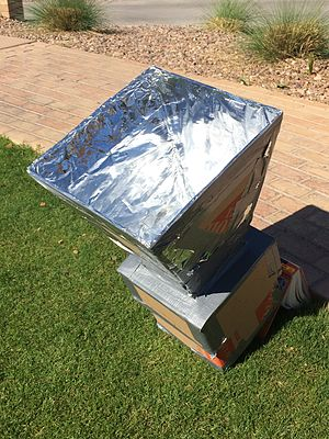 Solar cooker - A Solar Oven made of cardboard, newspapers, and reflective tape