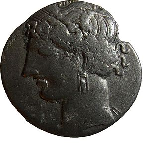 Tanit - A Punic coin featuring Tanit, minted in Punic Carthage between 215-205 BC.