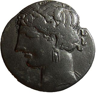Tanit - A Punic coin featuring Tanit, minted in Punic Carthage between 215 and 205 BCE.