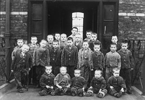 Foster care in the United Kingdom - Children from a workhouse in Cheshire - similar to these children at Crumpsall workhouse.(c.1895) - were the first to be placed in foster care in the United Kingdom in 1853.