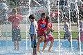 Children play in fountain at the Colorado State Fair.jpg