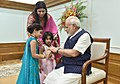 Children tying 'Rakhi' on the Prime Minister, Shri Narendra Modi's wrist, on the occasion of 'Raksha Bandhan', in New Delhi on August 07, 2017 (1).jpg