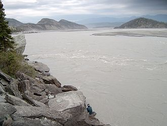 Copper River (Alaska) - A fisherman (bottom center) dipnetting for salmon on the Copper River at Chitina in Southcentral Alaska
