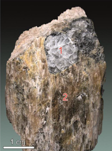Chkalovite crystals in manaksite.png