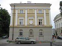 In 1817-27, Chopin's family lived in this Warsaw University building, now adorned (center) with Fryderyk's profile, adjacent to the Kazimierz Palace.
