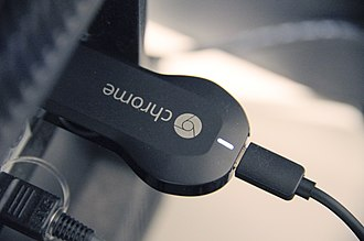 Chromecast - A first-generation Chromecast plugged into the HDMI port of a TV