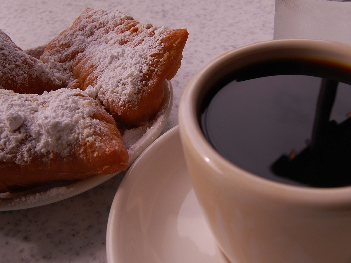 Coffee and doughnuts at Cafe Du Monde, New Orleans, Louisiana.jpg