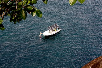 Lover's Leap - Couple approaching boat after they swim in lover's leap spot, Trincomalee