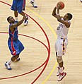 Craig Brackins over Sherron Collins.jpg