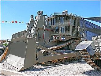 IDF Caterpillar D9 - IDF D9R armored bulldozer with add-on slat armor on display, 2008.