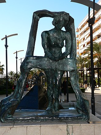 "Gala Dalí - Gala asomada a la ventana (""Gala leaning out the window""), sculpture by Dalí, in Marbella"