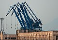 Dalian Liaoning China Crane-booms-in-Dalian-harbour-01.jpg