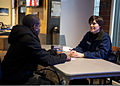 Danae Hoekstra, right, a personal finance manager with Fleet and Family Support Center Everett, conducts a one-on-one session with U.S. Navy Interior Communications Electrician 3rd Class Jonathan Young, assigned 130228-N-FR671-002.jpg
