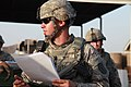 Defense.gov News Photo 100602-A-9759M-124 - U.S. Army Staff Sgt. Samuel Ward team leader and convoy commander gives a pre-mission brief emphasizing safety and diligence to soldiers from the.jpg