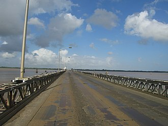 The Demerara Harbour Bridge crosses mouth of the Demerara River. It is a floating bridge. Demerara Harbour bridge crossing.JPG