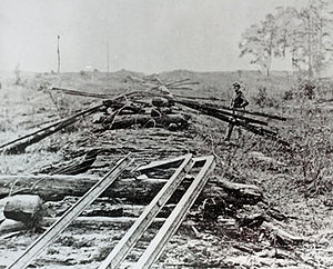 "Sherman's neckties - Some improperly-made ""Sherman's neckties"" . The photo clearly shows that those rails have been bent, not twisted as Sherman ordered them to be. In this state, they could potentially be repaired."