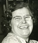 Detail of Kathleen Reynolds, first woman machine adjuster in the giant Winchester Ordnance plant, has 58 years of machine experience that is helping America's war effort (WWII) at Winchester Repeating Arms, New Haven, Conn. (cropped).jpg