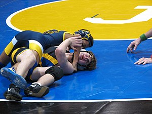 Scholastic wrestling - Student works for a fall