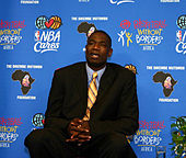 Dikembe Mutombo speaking to the press