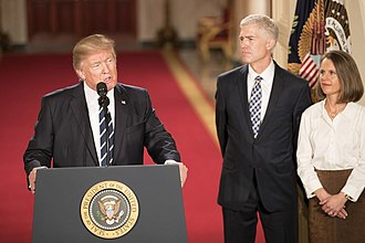 Neil Gorsuch - President Donald Trump introduces Gorsuch, accompanied by his wife, as his nominee for the Supreme Court at the White House on January 31, 2017.