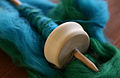 Drop spindle with wool.jpg