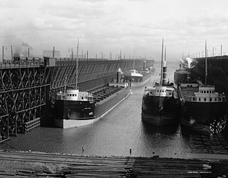 Duluth, Missabe and Iron Range Railway - DMIR ore docks loading ships, circa 1900-1915.