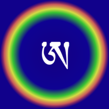 White symbol in multi-coloured circle, against a blue background