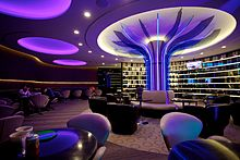 Lounge interior. An open seating area with a glowing column.
