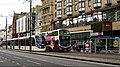 Edinburgh Trams tram & Lothian Buses bus, Princes Street, 24 April 2014.jpg