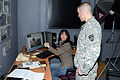 Elena Baladelli, left, a visual information specialist with the 7th U.S. Army Joint Multinational Training Command, helps a Soldier select images at the Camp Darby photo studio in Livorno, Italy, March 27 130327-A-IG394-065.jpg
