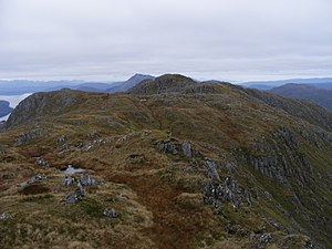 Sgùrr nan Eugallt - Looking north west from the triangulation point to the highest point. Beinn Sgritheall, 13 km, 974 m can be seen level with and just to the left of the highest point.