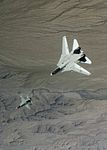 F-14A of VF-143 chases VF-43 T-38A c1980.jpg