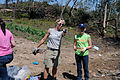 FEMA - 44113 - AmeriCorps Member Provides Direction to Other Volunteer in MS.jpg