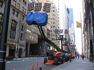 Location shooting - Between shoots for ''The Sorcerer's Apprentice'' at Bowling Green in New York City, lighting equipment was parked on Broadway.