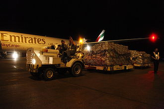 Mactan–Cebu International Airport - A Boeing 777F operated by Emirates SkyCargo at the airport with relief goods for Typhoon Haiyan/Yolanda donated by the United Kingdom's Department for International Development
