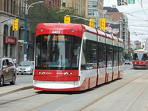 510 Spadina - Flexity Outlook streetcar southbound on Spadina Ave. south of Queen St.