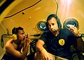 Flickr - Official U.S. Navy Imagery - A U.S. Navy Diver and a member of the Royal Malaysian Navy give a thumbs-up while in the recompression chamber..jpg