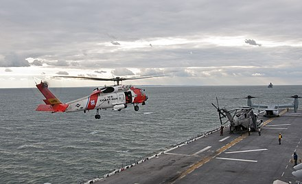 A U.S. Coast Guard helicopter preparing to land on the flight deck of the amphibious assault ship USS Wasp (LHD-1) Flickr - Official U.S. Navy Imagery - U.S. Coast Guard helicopters land aboard USS Wasp..jpg