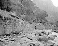 Flood damage to rock wall on Virgin River, a quarter mile south of Court of Patriarchs. Record of damage or defective (0ed98710ed824bb990bf059c123f4c03).jpg