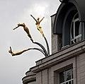 Flying Gold Women (4869646057).jpg