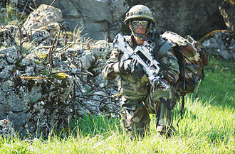 Operational Mentoring and Liaison Team - A French soldier stands guard amongst some ruins in the Joint Multinational Readiness Center training area in Hohenfels, Germany, May 14, 2008. The NATO Operational Mentorship and Liaison Team is preparing the soldiers for unit readiness prior to a deployment.