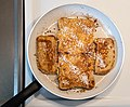 French toast with cinnamon and coconut flakes.jpg