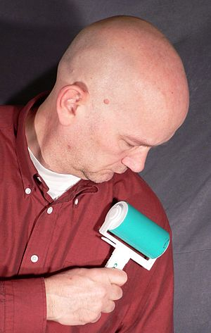 Lint remover - A lint roller in use.