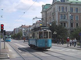 Gothenburg's popular trams travel the wide streets (the one shown in the foreground is a vintage tram used mostly by tourists).